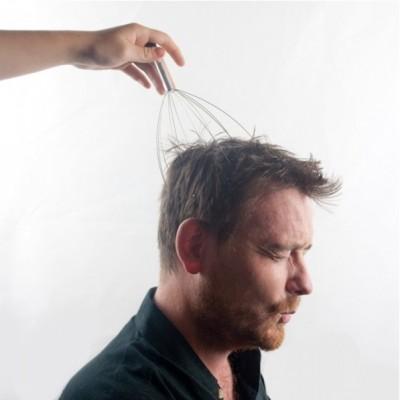 Pomôcka na masáž hlavy